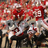 Beck Diefenbach – bdiefenbach@daily-chronicle.com<br /> <br /> A loose ball flies over the head of Wisconsin Nick Toon (1) and Northern Illinois Spencer Williamson (27)during the first half of the game against University of Madison at University of Wisconsin in Madison, Wisc., on Saturday Sept. 5, 2009. Wisconsin beat Northern Illinois 28 to 20.
