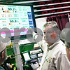 Beck Diefenbach  -  bdiefenbach@daily-chronicle.com<br /> <br /> Fred Blue, of Seed Express Systems USA, demonstrates the Seed Sense Corn Monitor during the 27th Annual Northern Illinois Farm Show at the Northern Illinois University Convocation Center in DeKalb, Ill., on Wednesday Jan. 7, 2009. Computerized corn seed monitoring allows a farmer to make adjustments as he works resulting in more efficient planting.
