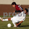 Beck Diefenbach  -  bdiefenbach@daily-chronicle.com<br /> <br /> Genoa-Kingston's Roberto Parra (7, bottom) collides with Northridge's Luke Diffenthallar (20) during first half of the regional playoff game at GK High School in Genoa, Ill., on Tuesday Oct. 13, 2009. After two overtime periods, the game was suspended due to darkness and will be restarted on Thursday at 4:30 P.M. at Genoa-Kington High School.