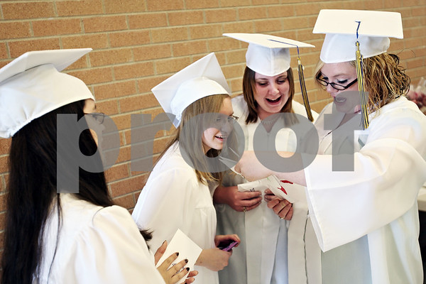 Beck Diefenbach  -  bdiefenbach@daily-chronicle.com<br /> <br /> Graduating seniors, from right, Katie Castleman, Tasha Krapausky, Kristine Taylor and Brenda Rodriguez share letters they had written to themselves as freshman before the ceremony at Somonauk High School in Somonauk, Ill., on Sunday May 31, 2009.
