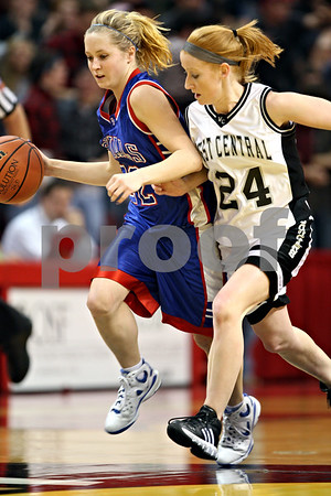 Beck Diefenbach – bdiefenbach@daily-chronicle.com<br /> <br /> Hinckley-Big Rock guard Maxzine Rossler dribbles past Winchester West Central guard McKea Fisher (24) during the fourth quarter of the Class 1A State Championship at the Redbird Arena in Normal, Ill., on Saturday Feb. 28, 2009.