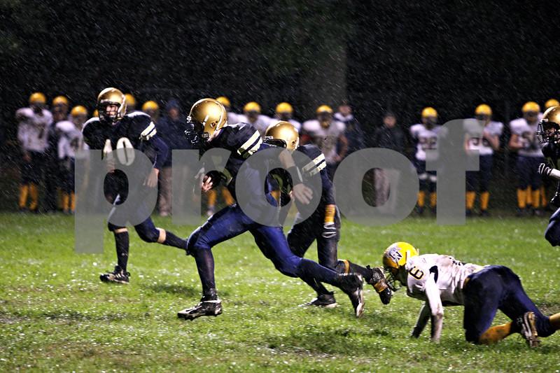 Rob Winner – rwinner@daily-chronicle.com<br /> Jason Keneway returns a punt 40 yards in the first quarter for a Hiawatha touchdown. Hiawatha hosted Luther High School North on Friday night.<br /> 10/02/2009