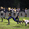 Rob Winner – rwinner@daily-chronicle.com<br /> Jason Keneway returns a punt 40 yards in the first quarter for a Hiawatha touchdown. Hiawatha hosted Luther High School North on Friday night.<br /> 10/02/2009