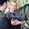 "Beck Diefenbach  -  bdiefenbach@daily-chronicle.com<br /> <br /> Bike mechanic Russ Stewart listens to Craig French, of Plano, explains what type of bike he is interested in at North Central Cyclery in DeKalb, Ill., on Thursday March 27, 2009. ""People are looking for an alternative, for saving money and exercise,"" said store owner Tobie DePauw. """