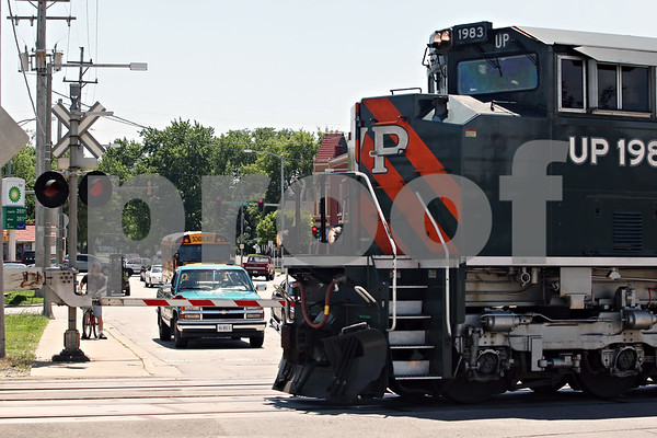 Beck Diefenbach  -  bdiefenbach@daily-chronicle.com<br /> <br /> Pedestrians and motorists wait as the Union Pacific Safety Train rolls through DeKalb on Tuesday June 23, 2009.