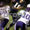 Beck Diefenbach  -  bdiefenbach@daily-chronicle.com<br /> <br /> Hiawatha running back Angel Hernandez (11) slips through North Shore Country Day School during the first quarter of the game at Hiawatha High School in Kirkland, Ill., on Friday Oct. 23, 2009.