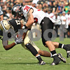 Beck Diefenbach – bdiefenbach@daily-chronicle.com<br /> <br /> Northern Illinois Mike Sobol (38) takes down Purdue Aaron Valentin (17) during the fourth quarter of the game in West Lafayette, Ind., on Saturday Sept. 19, 2009