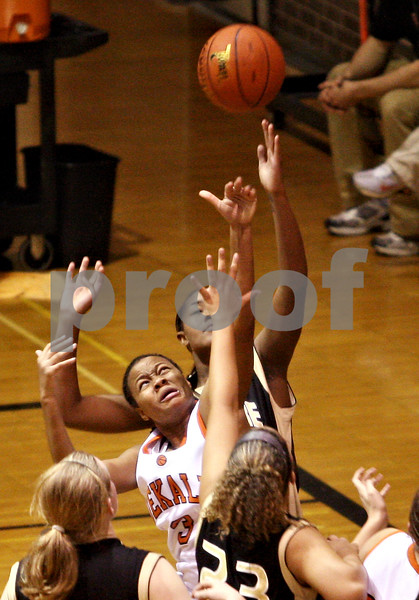 Beck Diefenbach  -  bdiefenbach@daily-chronicle.com<br /> <br /> DeKalb's Michelle Todd (3) leaps for a rebound during the third quarter of the game against Sycamore at DeKalb High School in DeKalb, Ill., on Tuesday Dec. 1, 2009. Sycamore defeated DeKalb 38 to 33.