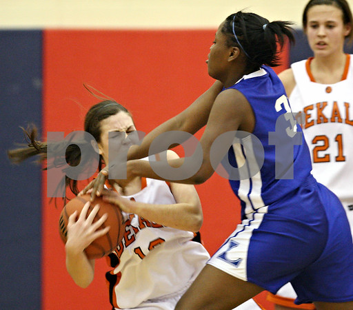 Beck Diefenbach  -  bdiefenbach@daily-chronicle.com<br /> <br /> DeKalb's Shelby Wood (12) falls to the ground after a struggle for the ball with Larkin's Tatiana Holbert (32) during the second quarter of the South Elgin Regional quarterfinal game at South Elgin High School in South Elgin, Ill., on Monday Feb. 16, 2009.
