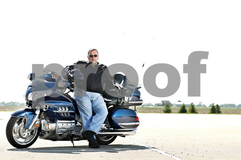 Beck Diefenbach  -  bdiefenbach@daily-chronicle.com<br /> <br /> Terry Clancy is training to be a Motorcycle Safety Foundation rider instructor. He believes wearing a helmet is very important but also supports a rider's right to choose not to wear one.
