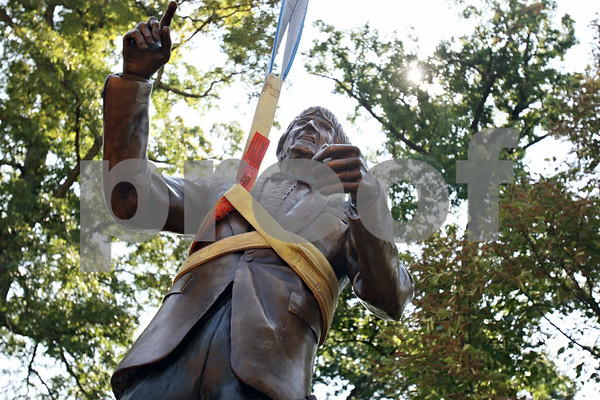 Rob Winner – rwinner@daily-chronicle.com<br /> The Dee Palmer sculpture is lowered into position by a crane on Wednesday morning near the bandshell at Hopkins Park.<br /> 08/12/2009<br /> Dee Palmer Sculpture at Hopkins<br /> DeKalb<br /> Don Morris - sculptor, plaid shirt<br /> Don Larson - yellowish shirt, dad of two boys<br /> Matt Larson - white shirt<br /> Ben Larson - orange shirt<br /> Ryan Schroeder - crane operator<br /> Herb Buhr - red shirt