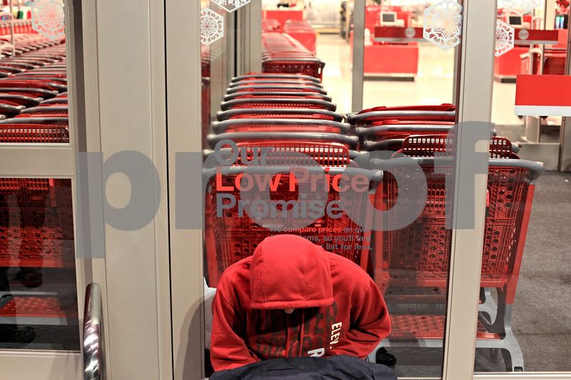 Beck Diefenbach  -  bdiefenbach@daily-chronicle.com<br /> <br /> Andrew Harvey, 16, of DeKalb, waits overnight for the new Target store to open in DeKalb, Ill., on Friday Nov. 27, 2009.