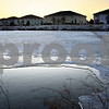 Beck Diefenbach – bdiefenbach@daily-chronicle.com<br /> <br /> Water hangs in limbo between solid and liquid in a retention pond near Pappas Park in DeKalb, Ill., on Thursday Feb. 19, 2009.