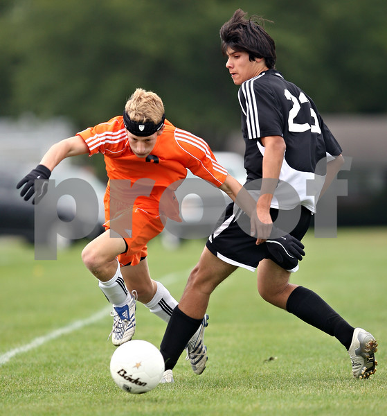 Beck Diefenbach  -  bdiefenbach@daily-chronicle.com<br /> <br /> DeKalb's Sammy Lake (2, left) takes the ball from Kaneland's Alex Dorado (23) during the first half of the game at DeKalb High School in DeKalb, Ill., on Monday Sept. 28, 2009.