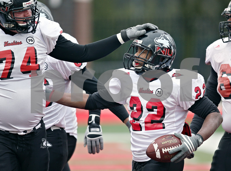 Beck Diefenbach  -  bdiefenbach@daily-chronicle.com<br /> <br /> Northern Illinois offensive lineman Adam Kiel (74) and tailback Ricky Crider (22) during practice at Huskie Stadium in DeKalb, Ill., on Tuesday April 14, 2009.