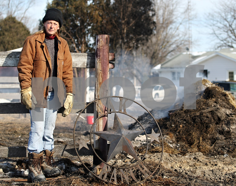 Beck Diefenbach  -  bdiefenbach@daily-chronicle.com<br /> <br /> Amy Klink and her family lost their horse barn which burned down Thursday on her family's ranch killing several animals in Clare, Ill., on Friday Feb. 6, 2009.