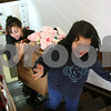 Rob Winner – rwinner@daily-chronicle.com<br /> Volunteers Alycia Lira, 15 of Waterman, and Emily Cho, 8 of DeKalb, help bring up a box full of stuffed animals from the basement of the YMCA in DeKalb, Ill. as Toys for Tots were distributed on Tuesday December 21, 2009.