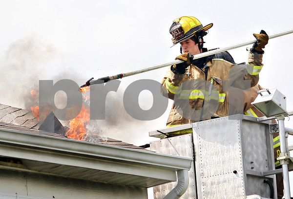 Beck Diefenbach  -  bdiefenbach@daily-chronicle.com<br /> <br /> A Cherry Valley firefighter uncovers flames in ceiling of a house at 800 Willow Rd. in Kirkland, Ill., on Monday May 11, 2009.