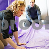 Beck Diefenbach  -  bdiefenbach@daily-chronicle.com<br /> <br /> DeKalb County Ramp manager Tina Vavra, left, measures table cloth on Tuesday May 19. 2009, while setting up for Ramp's 15 year celebration at their DeKalb, Ill., office.