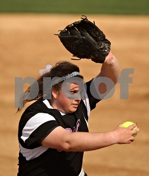 Beck Diefenbach  -  bdiefenbach@daily-chronicle.com<br /> <br /> Burlington Central pitcher Mackenzie Scott winds up during the first inning of the Class 3A super sectional game against Vernon Hills at Northern Illinois University in DeKalb, Ill., on Monday June 8, 2009.