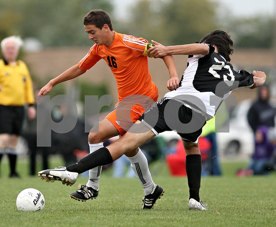 Beck Diefenbach  -  bdiefenbach@daily-chronicle.com<br /> <br /> DeKalb's Niko Tsiagalis (16, left) pulls away from Kaneland's Alex Dorado (23) during the first half of the game at DeKalb High School in DeKalb, Ill., on Monday Sept. 28, 2009.