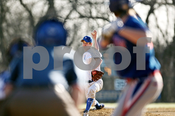 Beck Diefenbach  -  bdiefenbach@daily-chronicle.com<br /> <br /> Hinckley-Big rock pitcher Colton Craig (14) winds up during the bottom of the third inning against Newark High School in Big Rock, Ill., on Thursday April 16, 2009.