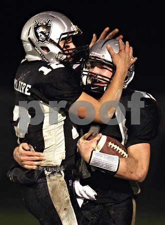 Beck Diefenbach  -  bdiefenbach@daily-chronicle.com<br /> <br /> Kaneland quarterback Joe Camiliere (12, left) celebrates with wide receiver Taylor Andrews (11) following their first touchdown during the second quarter of the game against Geneva at Kaneland High School in Maple Park, Ill., on Friday Oct. 16, 2009.