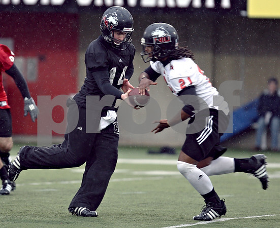 Beck Diefenbach  -  bdiefenbach@daily-chronicle.com<br /> <br /> Northern Illinois' Brandon Rogers (14) and David Pratt (21) during practice at NIU's Huskie Stadium in DeKalb, Ill., on Tuesday March 24, 2009.