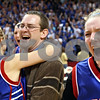 Beck Diefenbach – bdiefenbach@daily-chronicle.com<br /> <br /> Hinckley-Big Rock head coach Greg Burks (center) hugs Maxzine Rossler (left) as Jenna Thorp (right) celebrates their win over Winchester West Central High School in the Class 1A IHSA State Basketball Championships at the Red Bird Arena in Normal, Ill., on Saturday Feb. 28, 2009.