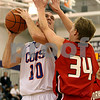 Rob Winner – rwinner@daily-chronicle.com<br /> Genoa-Kingston's Ethan Menges looks to shoot over Yorkville defender Derek Piszczek during the first half of their game on Monday December 28, 2009 in Plano, Ill.