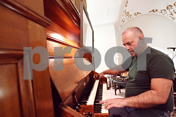 Beck Diefenbach  -  bdiefenbach@daily-chronicle.com<br /> <br /> Organ service technician Stephan Drexler, of Berghaus Pipe Organ Builders, tests the organ at St. Mary's of the Assumption Church in Maple Park, Ill., on Friday March 20, 2009. Drexler was tuning the organ in preparation of the future performance.
