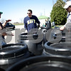 Beck Diefenbach  -  bdiefenbach@daily-chronicle.com<br /> <br /> Resource conservationist Dean Johnson (left) and Scott Pumroy (right), director of the DeKalb County Soil and Water Conservator District, explain the function of a rain water collection barrel to Donald Brown (center), of Sycamore, who was picking up his rain barrels at the DeKalb County Farm Bureau in Sycamore, Ill., on Friday April 17, 2009.