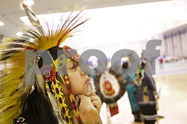 Beck Diefenbach  -  bdiefenbach@daily-chronicle.com<br /> <br /> Steve King, of Oneida, Wisc., dons his regalia before taking part in the grand entry for the 17th Annual Scholarship Powwow held by Northern Illinois University N.A.T.I.O.N.S. in the Student Recreation Center on campus in DeKalb, Ill., on Saturday Nov. 7, 2009.