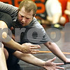 Beck Diefenbach  -  bdiefenbach@daily-chronicle.com<br /> <br /> DeKalb wrestling team assistant coach Sam Hiatt, right, demonstrates moves with Devin Walker during practice in the pool at DeKalb High School in DeKalb, Ill., on Friday Dec. 4, 2009.
