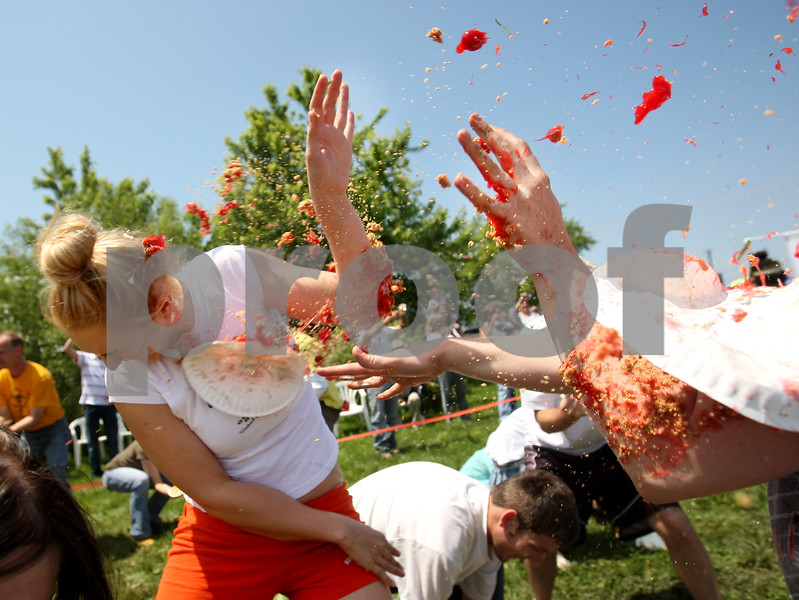 Beck Diefenbach  -  bdiefenbach@daily-chronicle.com<br /> <br /> Sarah Bradley, of Genoa, is hit with a cherry pie during the world's largest pie fight in Genoa, Ill., on Saturday June 13, 2009. Over 200 people participated.