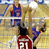 Rob Winner – rwinner@daily-chronicle.com<br /> In the first game, Hinckley-Big Rock's Katie Hollis looks for a kill over Mooseheart's Santana Sanchez during the IHSA Class 1A Westminster Christian Regional in Elgin on Wednesday October 28, 2009.
