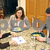 Beck Diefenbach  -  bdiefenbach@daily-chronicle.com<br /> <br /> (From left) Aaron, 6, talks about his day as his mother Lesley Rigg and father David Goldblum, eat vegetarian black bean and corn quesadillas for dinner at the family's Sycamore home on Tuesday Nov. 17, 2009. Rigg and Goldblum has raised their children to be vegetarians as well.