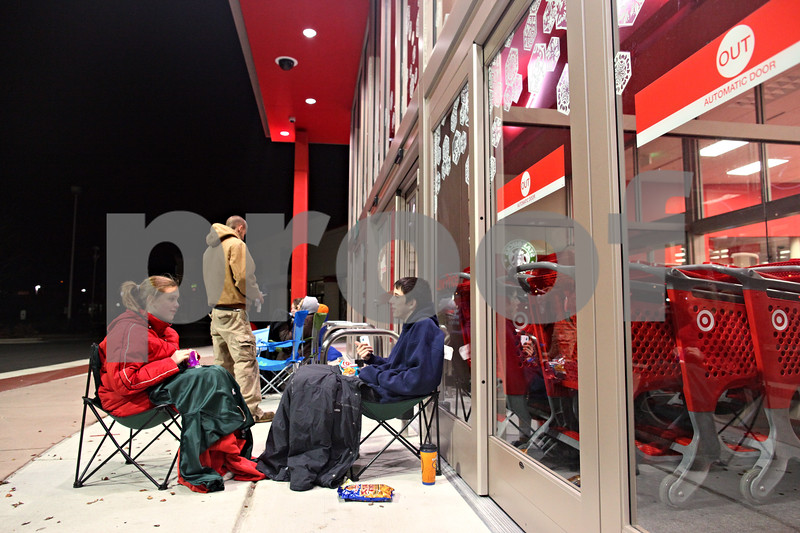 Beck Diefenbach  -  bdiefenbach@daily-chronicle.com<br /> <br /> Cousins, Destiny Johnson, 14, and Brian Mitchell, 16, both of DeKalb, wait overnight for the new Target store to open in DeKalb, Ill., on Friday Nov. 27, 2009. Johnson and Mitchell had a long list of items to purchase including movies, dvd players, and an electric drum set.