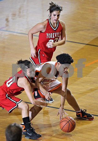 Beck Diefenbach  -  bdiefenbach@daily-chronicle.com<br /> <br /> DeKalb guard forward Deyonna Dunigan (22) and Yorkville guard Alexis Redman (20) attempt to claim a loose ball during the second quarter of the game at DeKalb High School in DeKalb, Ill., on Tuesday Jan 13, 2008.