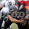 Rob Winner - rwinner@daily-chronicle.com<br /> <br /> Kaneland's Joe Camiliere (left) tackles DeKalb running back Spencer Blank-Jones during the second quarter.<br /> <br /> 10/10/2009