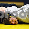 Beck Diefenbach – bdiefenbach@daily-chronicle.com<br /> <br /> Sycamore wrestler Jake Lancaster holds down his teammate during practice on Wednesday Feb. 18, 2009.