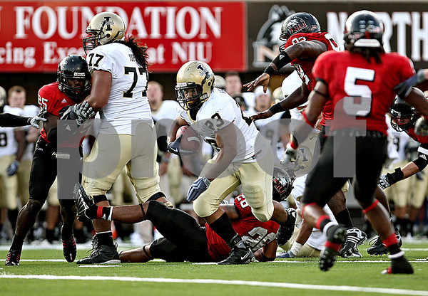 Rob Winner – rwinner@daily-chronicle.com<br /> De'Maundray Woolridge (23) is able to keep the chains moving and the clock running during Idaho's last drive. Idaho went on to defeat NIU, 34-31, on Saturday.<br /> 09/26/2009