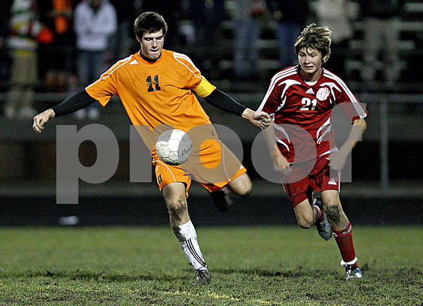 Rob Winner – rwinner@daily-chronicle.com<br /> DeKalb's Jake Johnsen kicks the ball into Marian territory during the first half.