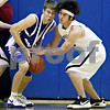 Beck Diefenbach – bdiefenbach@daily-chronicle.com<br /> <br /> Central's Shane Larkin (30) and Sycamore's Harlan Johnson (24) bump heads during the first quarter of the regional semi-final game at Central High School in Burlington, Ill., on Monday March 2 , 2009.