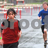 Randi Stella – rstella@daily-chronicle.com<br /> <br /> Kyle Love, part of the Huskie Track Club, (left) finishes running the 3000 meter dash with Tim Ehrhardt (right), of the DuPage Track Club at the Youth Invitational Track Meet in DeKalb, Ill., on Saturday, June 13th, 2009.