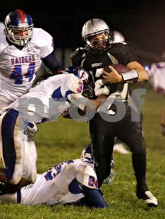 Beck Diefenbach  -  bdiefenbach@daily-chronicle.com<br /> <br /> Kaneland quarterback Joe Camiliere  (12, right) is taken down by Glendbard South's Pat Childs (85, bottom) and Connor Douglas (3) during the first quarter of the game at Kaneland High School in Maple Park, Ill., on Friday Oct. 2, 2009