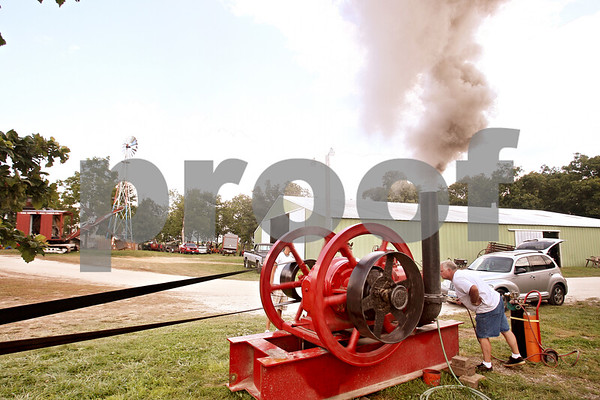 Beck Diefenbach  -  bdiefenbach@daily-chronicle.com<br /> <br /> A 1930 diesel powered water pump warms up in preparation for the Sycamore Steam Show & Threshing Bee in Sycamore, Ill., on Wednesday August 12, 2009.