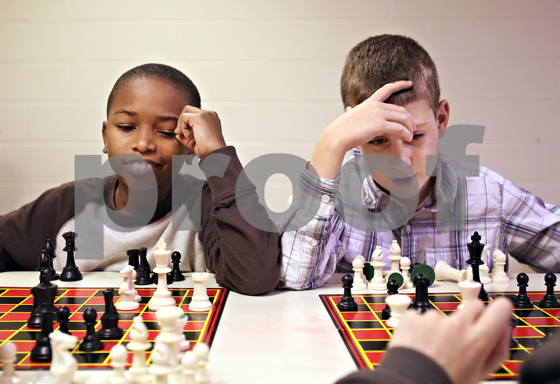 Beck Diefenbach  -  bdiefenbach@daily-chronicle.com<br /> <br /> Fourth grader Cole Swafford, right, and third grader Johnny Brooks contemplate their options during chess club at Tyler Elementary School in deKalb, Ill., on Monday Dec. 7, 2009.