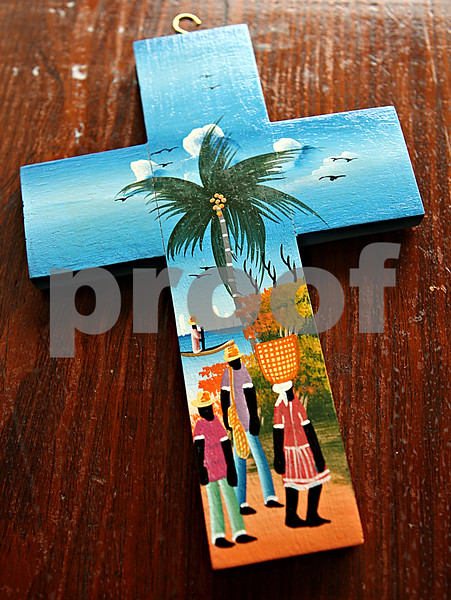Rob Winner – rwinner@daily-chronicle.com<br /> <br /> Julia Jones found this cross in Haiti during a trip last year. The cross now hangs on a wall within Hinckley First United Methodist Church.<br /> <br /> 10/16/2009