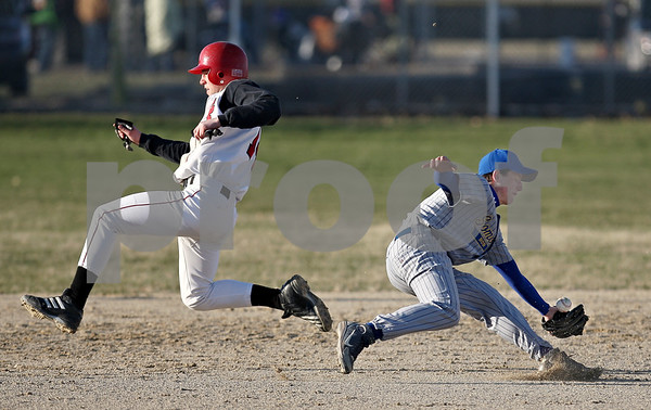 Beck Diefenbach  -  bdiefenbach@daily-chronicle.com<br /> <br /> Indian Creek Nathan Peterson (14) slips past Somonauk's Brock Kartheiser (3) during the bottom of the sixth inning at Indian Creek High School in Shabbona, Ill., on Friday April 3, 2009.